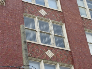 Example of paint deterioration on historic wood windows, though wood remains in sound condition for the time being.