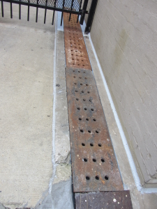 Example of urban trench drain to carry run-off to street curb.