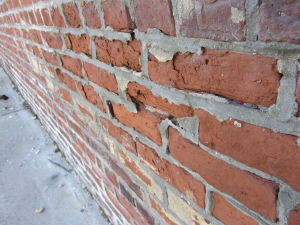 Example of improper repointing with portland cement causing historic brick to spall due to different compressive strengths.